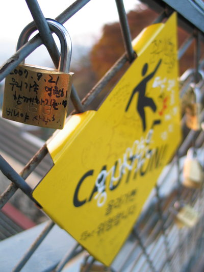 Little locks were affixed to the chainlink fence atop the Seoul Tower